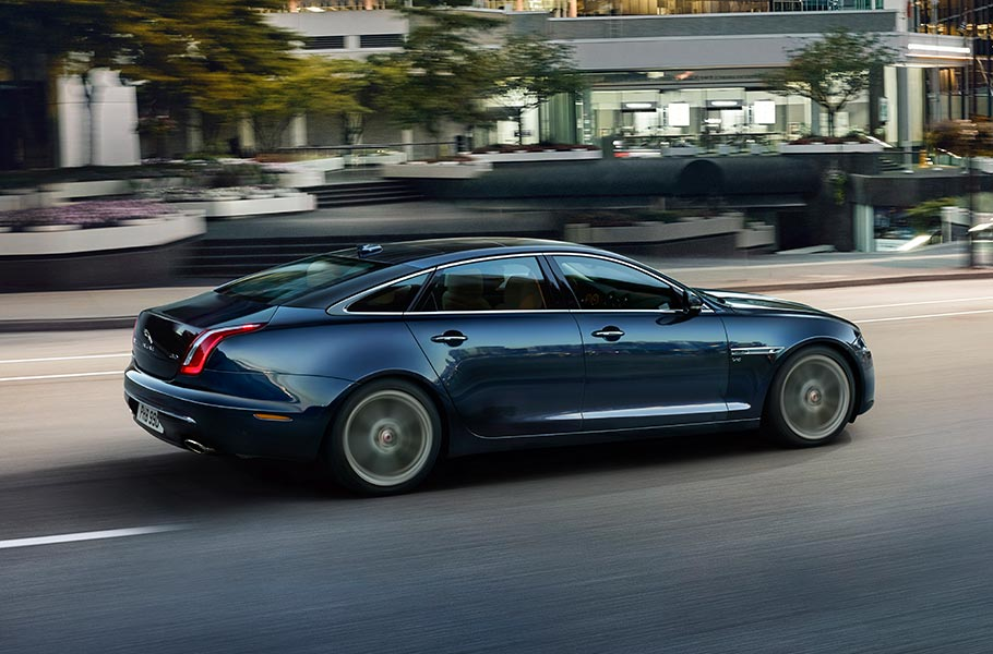 Jaguar XJ driven on road