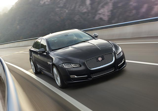 Dark Grey Jaguar XJ driven on road