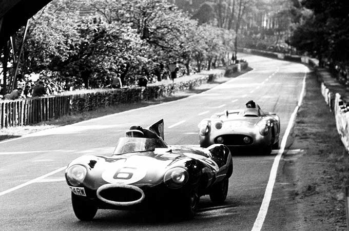 Mira Sayer & Dewis stand behind the 1955 Jaguar D-type.