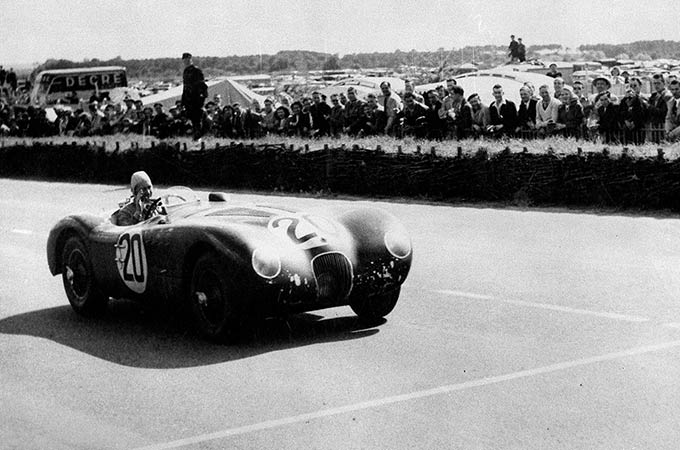 Jaguar C-type, driven by Peter Whitehead and Peter Walker crosses the line to win the 1951 Le Mans.