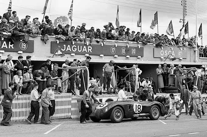 Celebrations in the pits for Jaguar, after the C-TYPE claims another Le Mans title, in 1953.