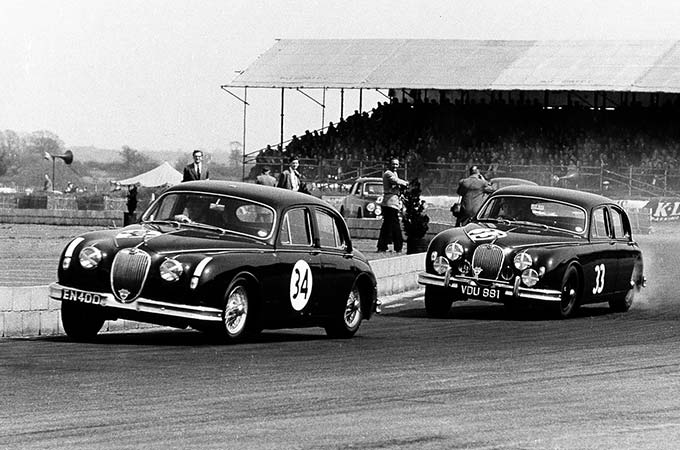 The Jaguar Mark II drives at Silverstone, in 1960.