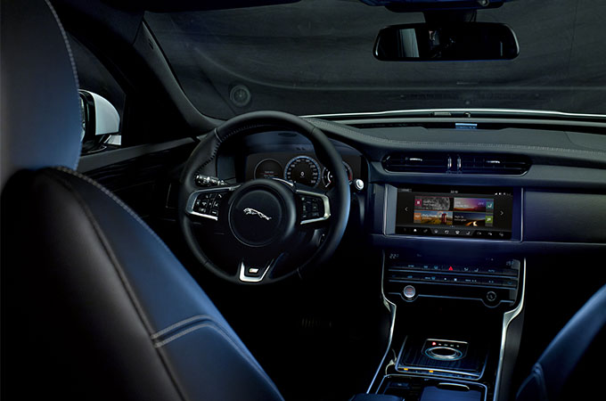 Jaguar XF's steering wheel, dashboard and control centre.