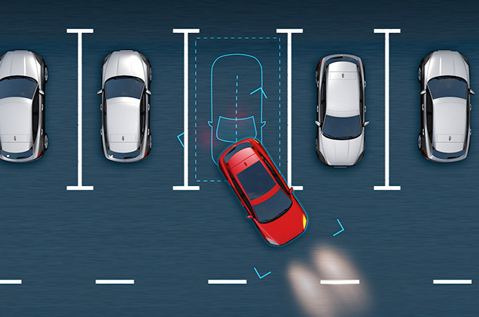 Diagram showing the Jaguar E-Pace's park assist measuring a bay as an E-Pace reverses into it.