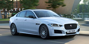 White Jaguar XE Landmark Model driven on city road