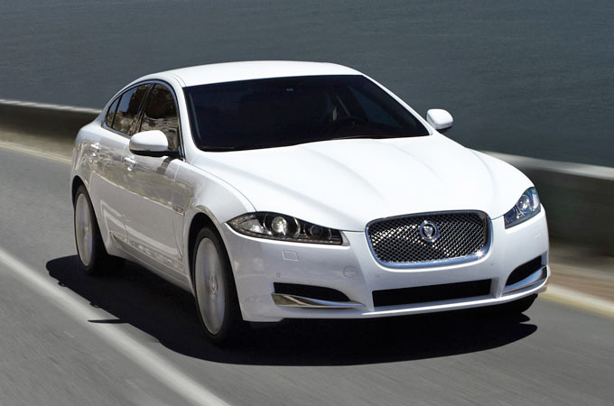 XF Saloon driving along coastal road.