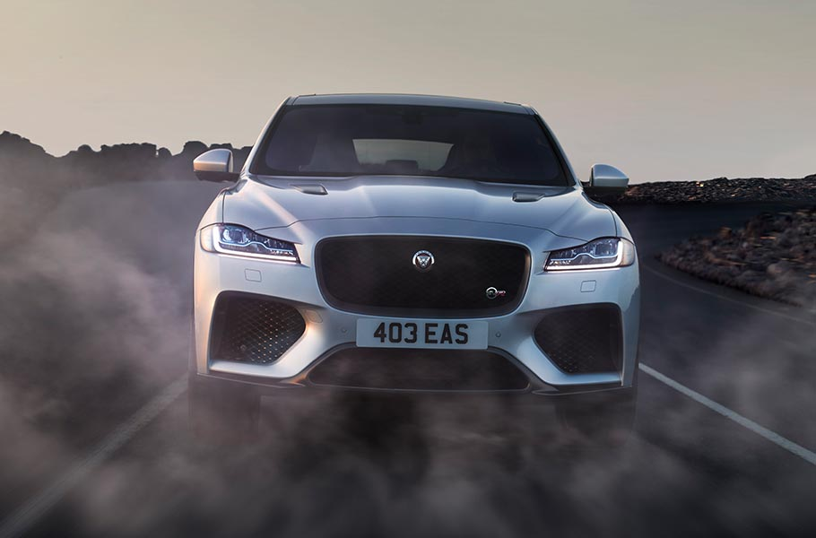 Front View Grey Jaguar F-PACE SVR driven on desert open road