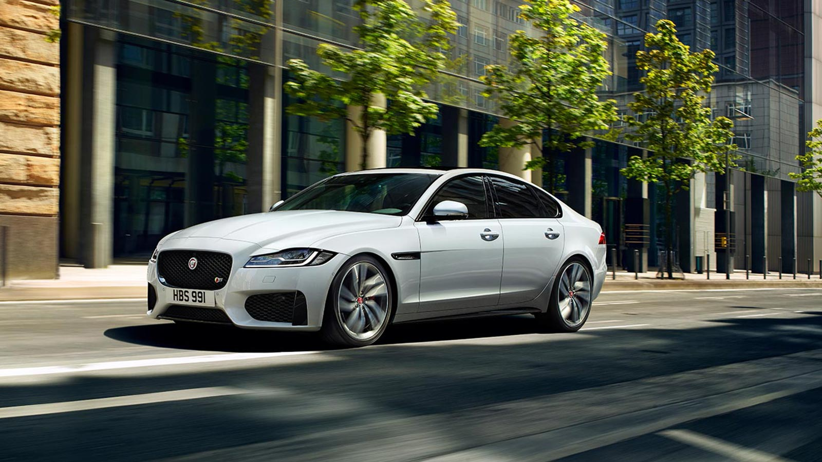 Jaguar XF Driving Along Road.