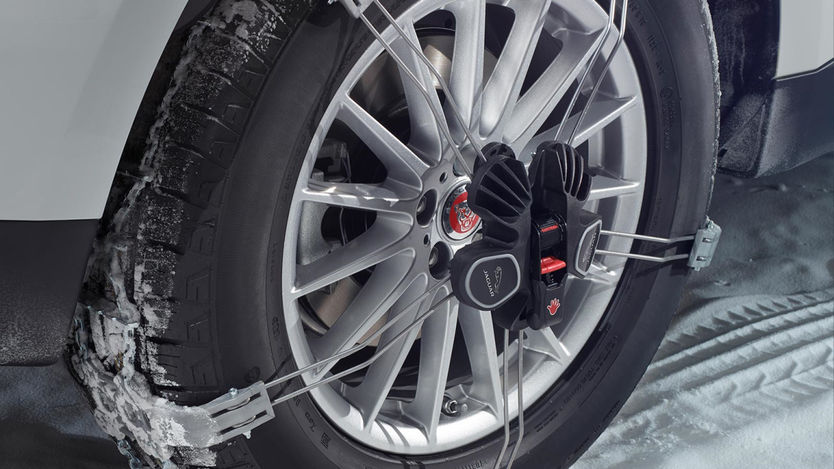 Jaguar Traction Aids on a car wheel in the snow