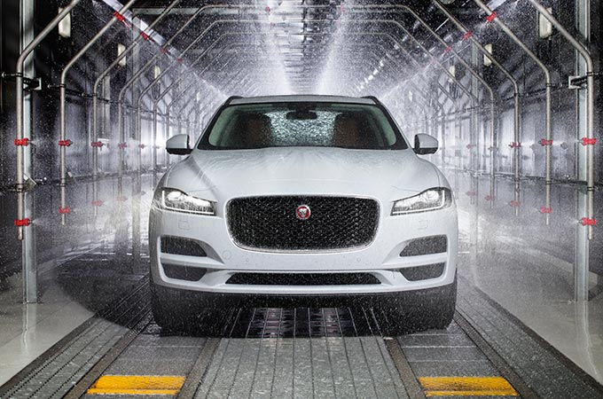 White Jaguar F-Pace being water tested.