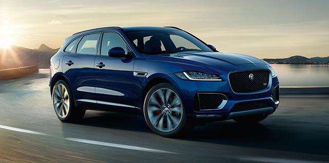 Jaguar F-PACE in Caesium Blue driven on road