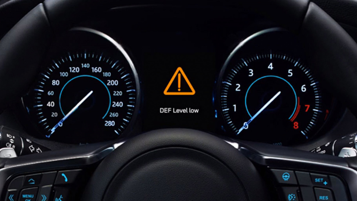 Jaguar F-Pace Diesel Exhaust Fluid warning on a screen in the car.