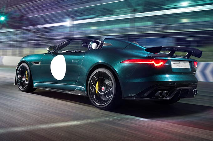 Jaguar F-TYPE Project 7, racing on a track at night.