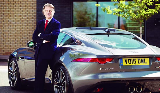 Jaguar CEO, Ralf Speth at a speech with the Jaguar logo behind.