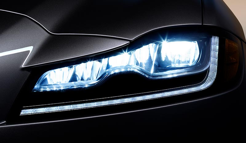 Close-up of a Jaguar XF headlight.
