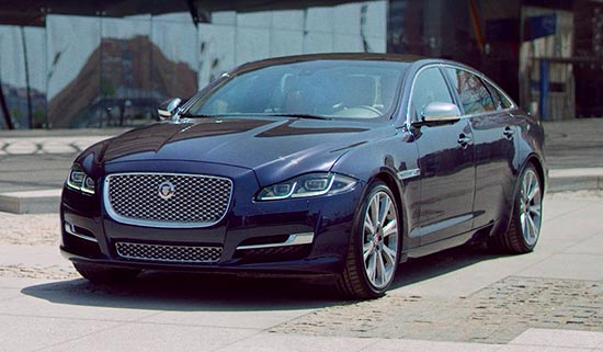 Front view of a dark blue Jaguar XJ.