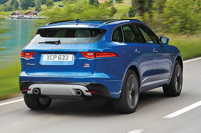 Jaguar F-PACE in blue from above driving along a road.