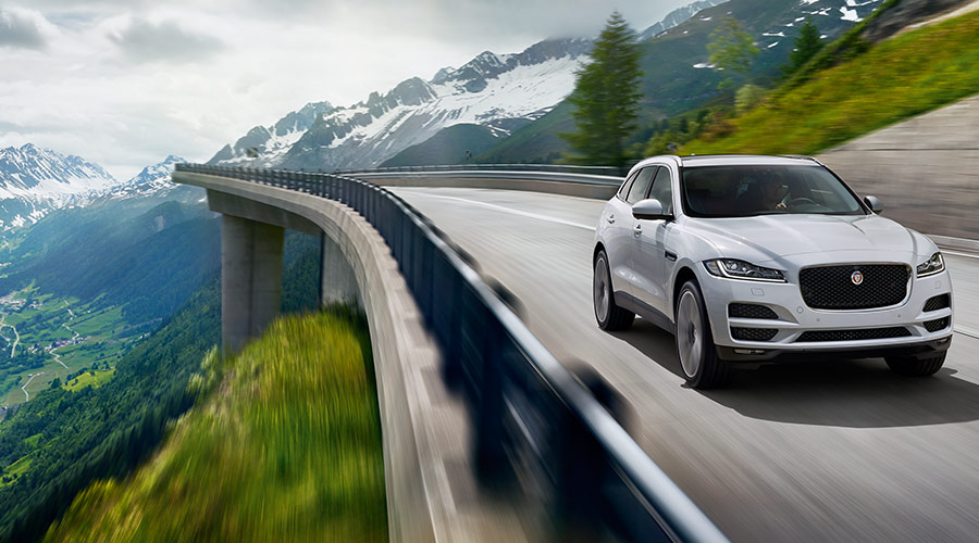 Jaguar F-Pace Portfolio driving on a bridge