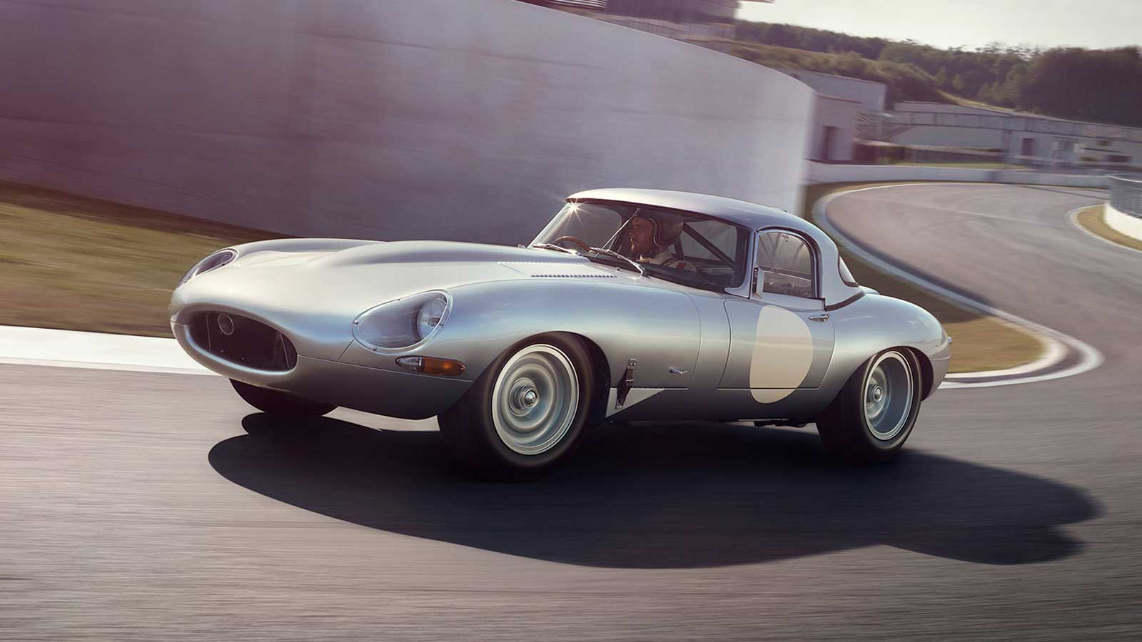 Jaguar Lightweight E-TYPE coming off a bend on a race track.