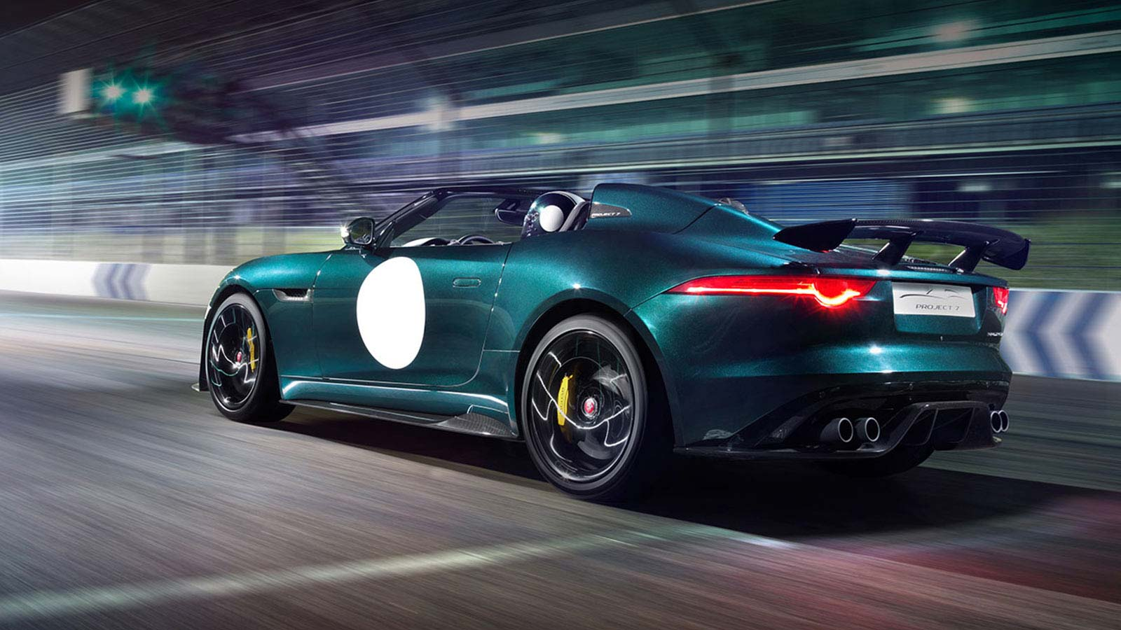 Jaguar F-TYPE Project 7 from behind racing in the dark.