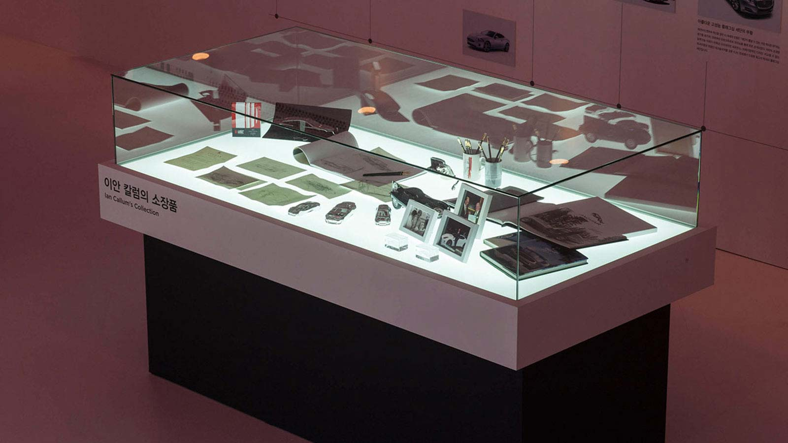 A glass box displaying items from Director of Design, Ian Callum's collection.
