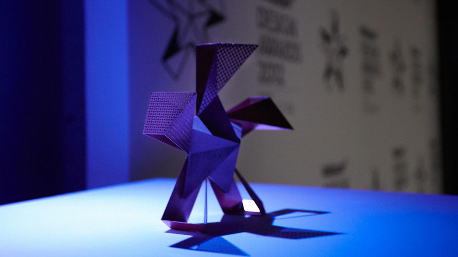 A star-like structure in a blue light on display at the Wallpaper* Handmade Exhibition.