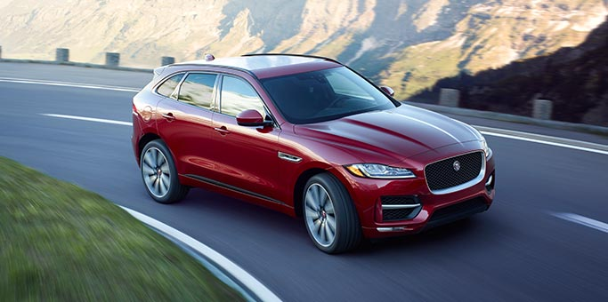 Red Jaguar F-PACE on Winding Road