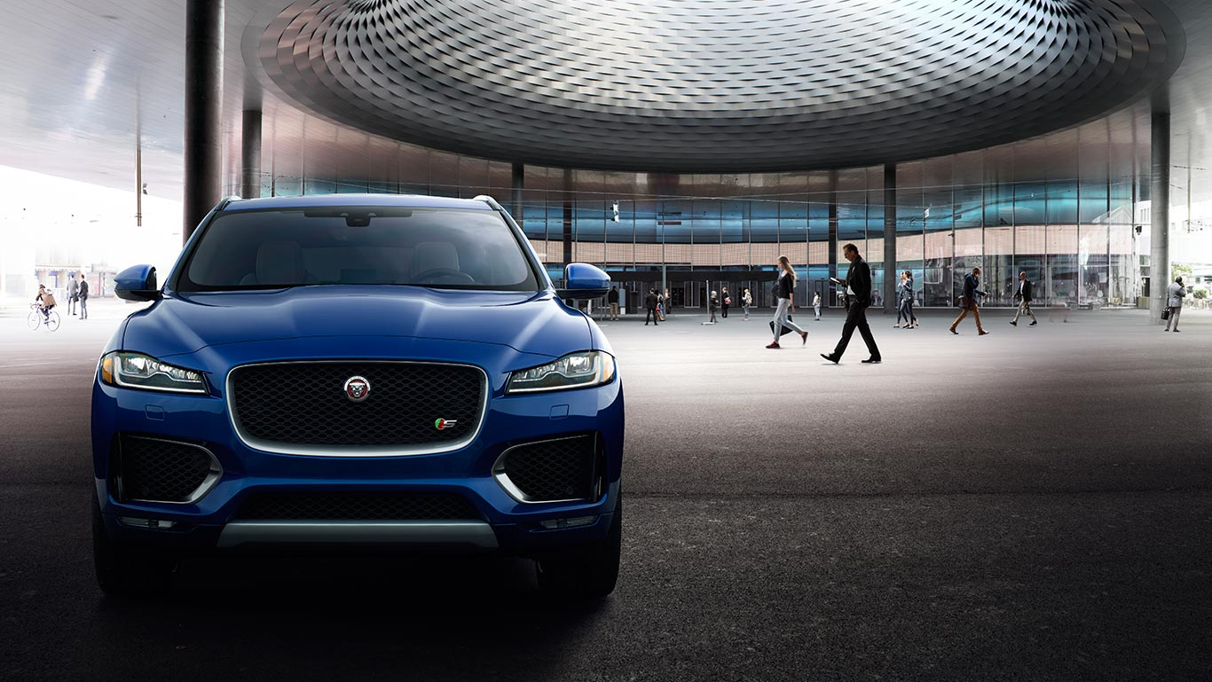 Blue Jaguar F-PACE with Pedestrian Traffic