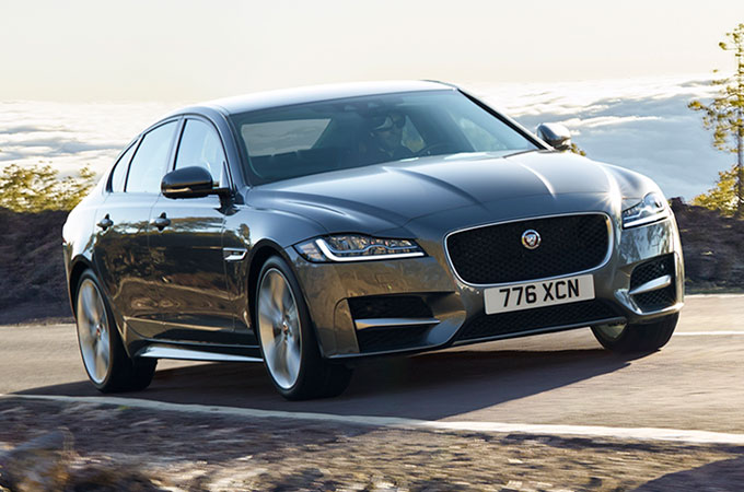 Jaguar XF Saloon Driving Along Road.