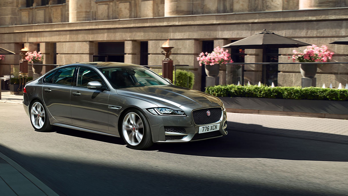 Jaguar XF Driving In Town For Business.