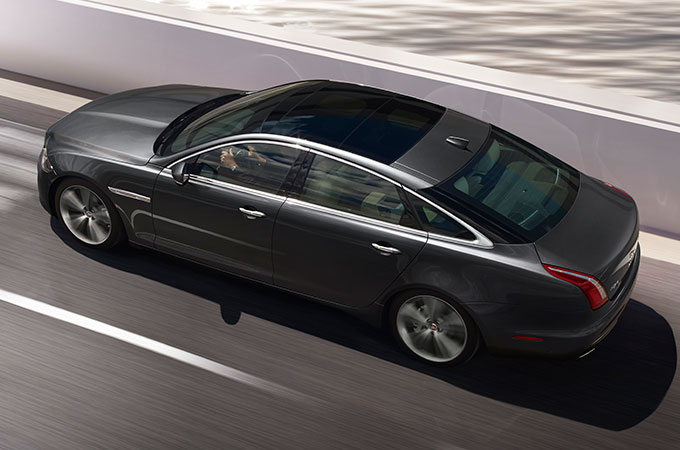 Jaguar XJ Long Wheelbase Driving On Road.