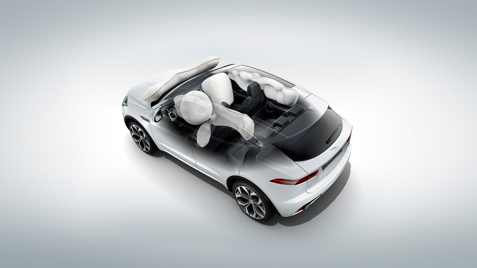 Transparent view of the Jaguar E-Pace's airbag deploy points, including the pedestrian on the windscreen.