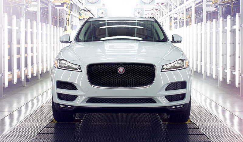 A parked Jaguar F-PACE in a quality inspection bay.