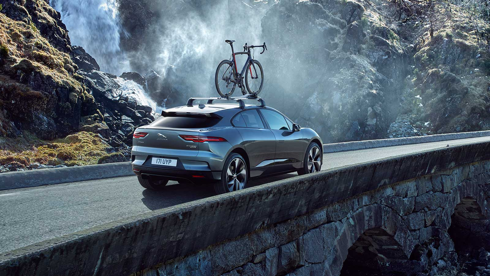 Jaguar I-Pace Carrying a bicycle on its roof.