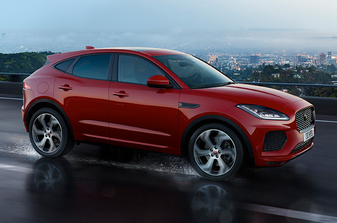 Jaguar E-PACE driving along a road.