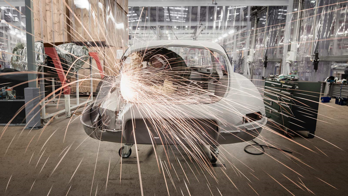 Sparks flying from mechanical work on the chassis of a Jaguar E-TYPE.