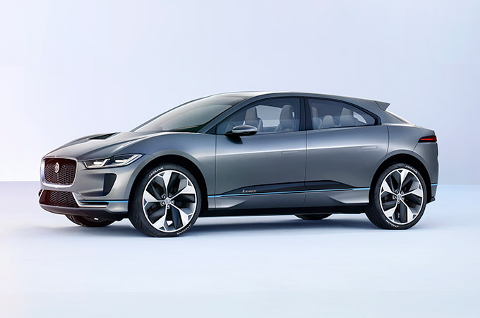 Grey Jaguar I-PACE concept car in a studio.