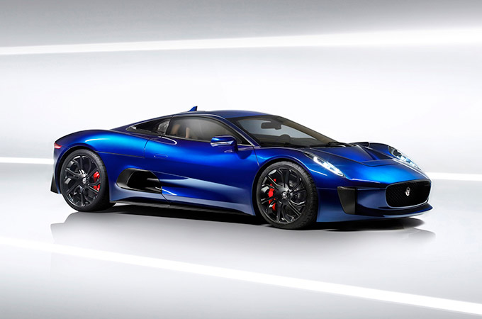 Blue Jaguar C-X75 concept car in a studio.