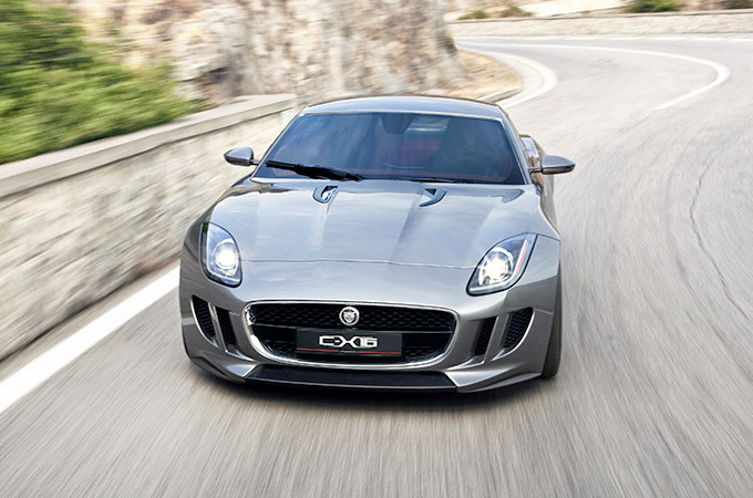 Grey Jaguar C-X16 concept car driving along a winding road.