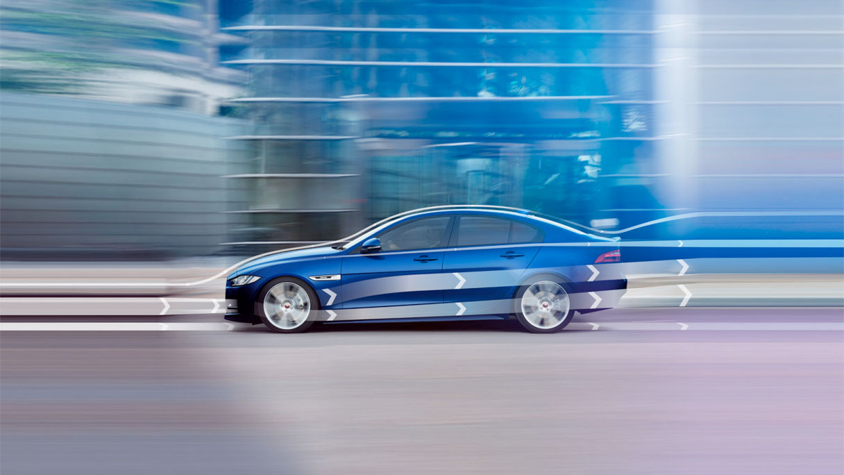Jaguar XE, from the side, detailing its advanced aerodynamics.
