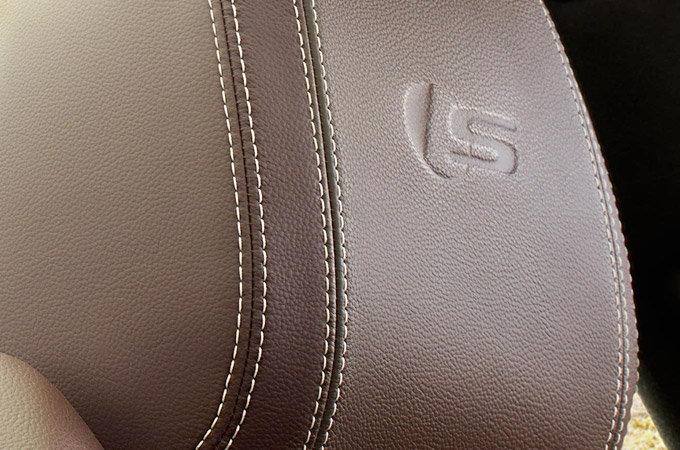 Jaguar XF headrest with S embossing.