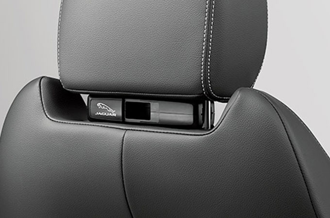 Close-up of Jaguar E-Pace Click and Go mounted on a headrest.