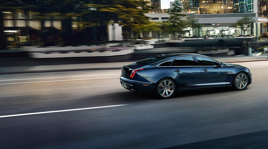 XJ on the road in motion.