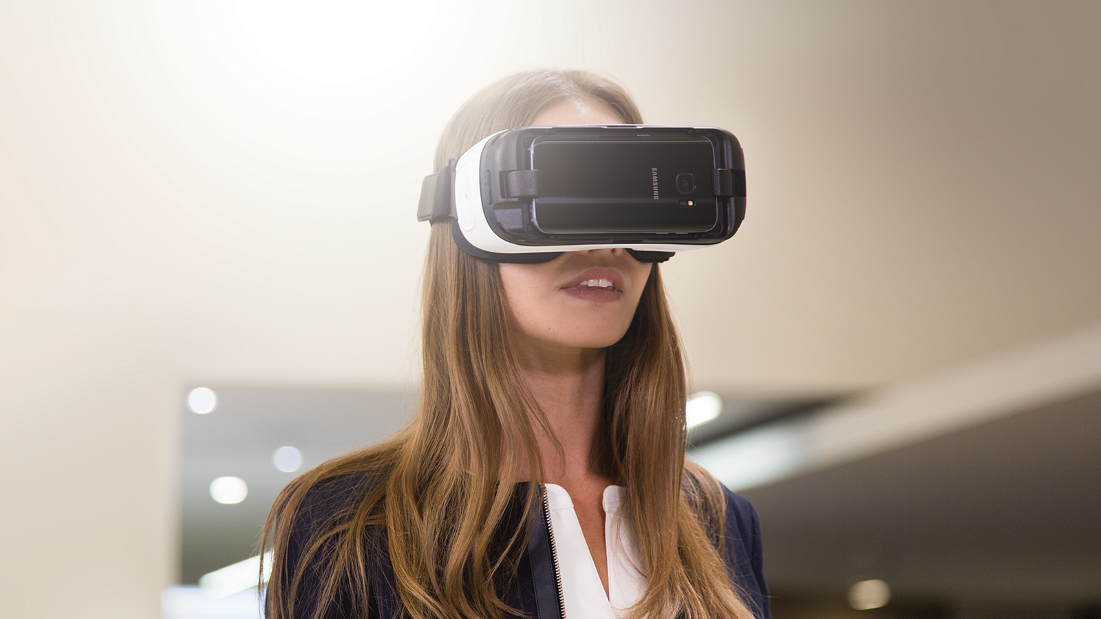 A woman wearing a VR headset