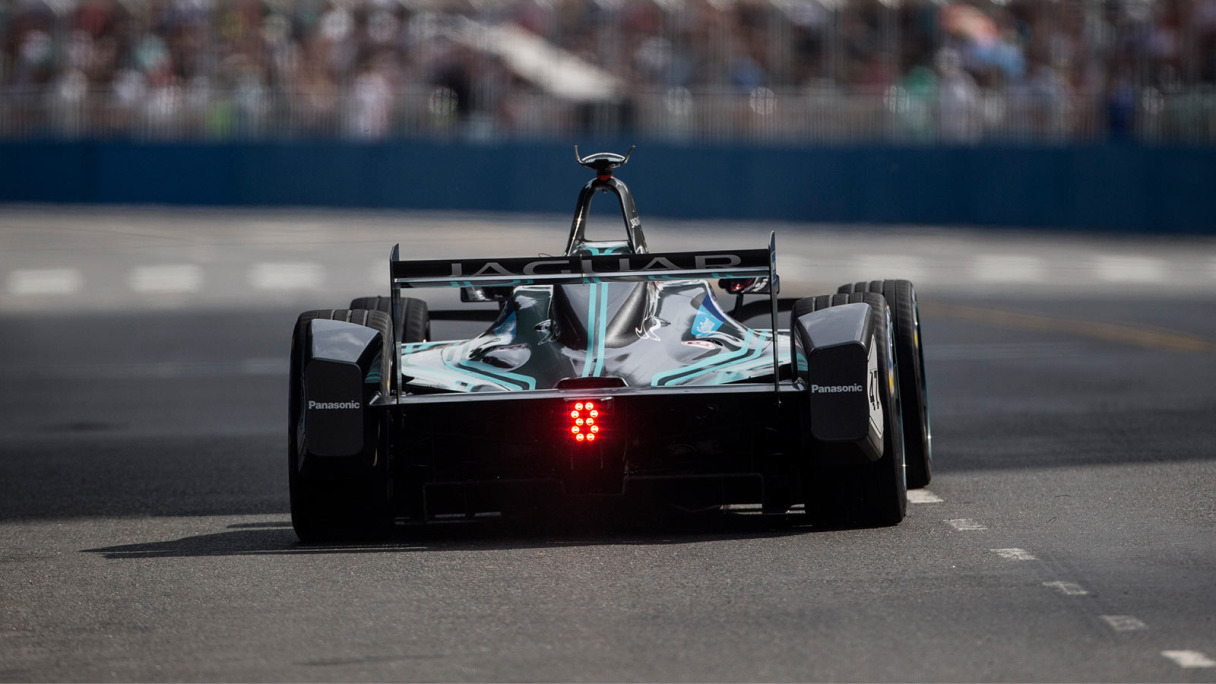 Rear view of Jaguar Racing's I-TYPE 2, driving on-track.