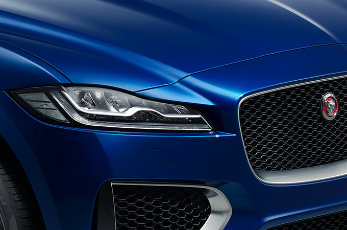 Close-up of Jaguar model's mesh grille and headlights.