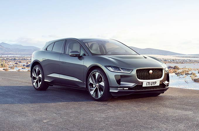 Silver I-PACE with mountains in the background.