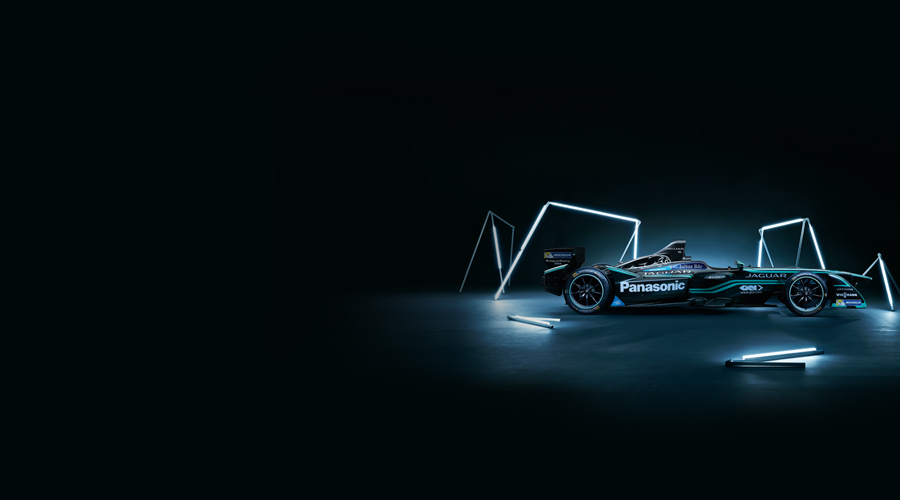 Side view of Jaguar Racing's I-TYPE 2, surrounded by lighting rods.