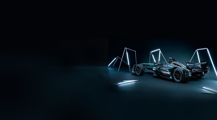 Side-rear view of Jaguar Racing's I-TYPE 2, surrounded by lighting rods.