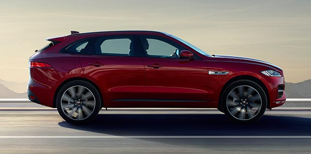 Red Jaguar F-PACE R-Sport Model driven on road